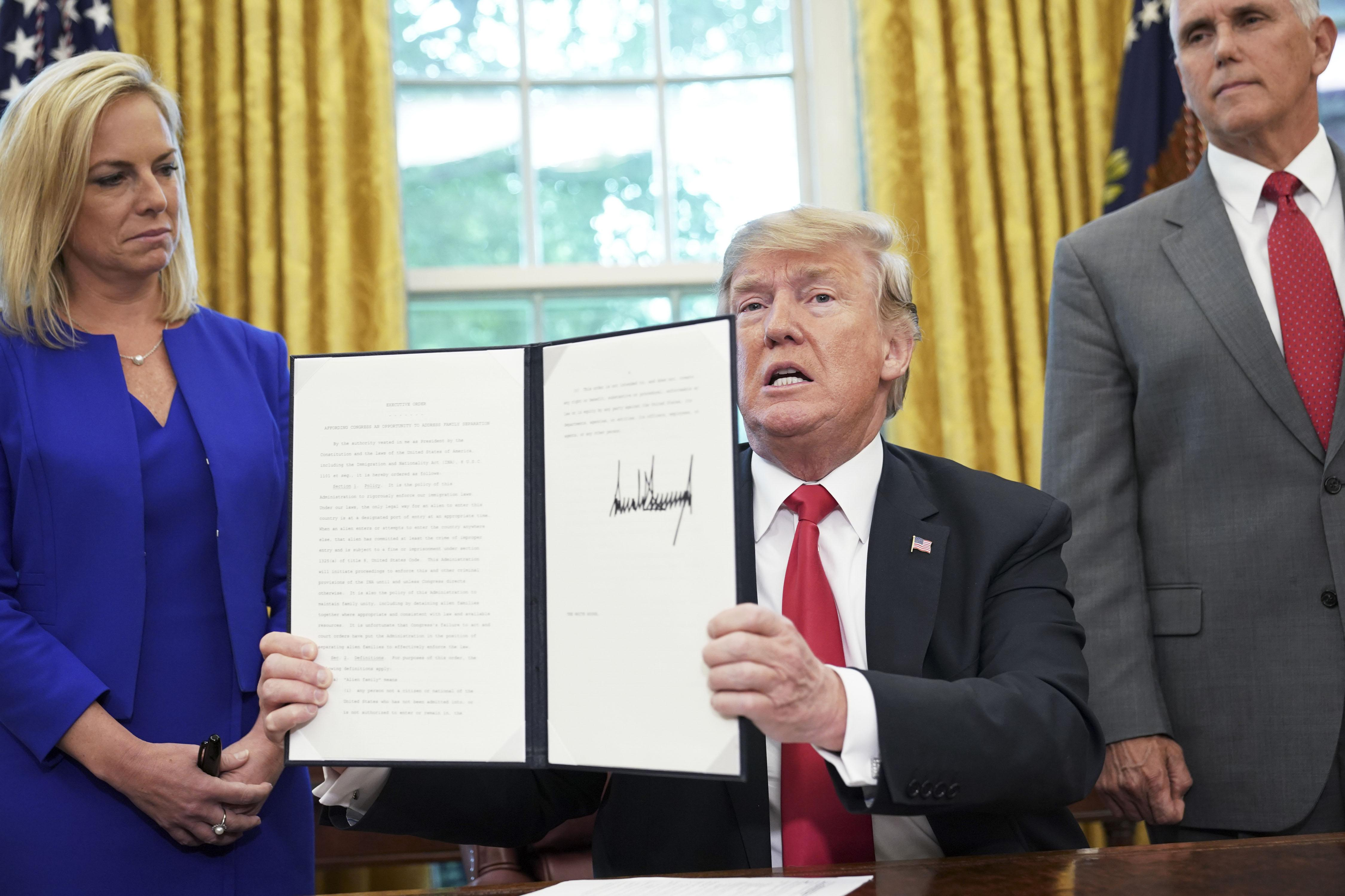 Kirstjen Nielsen, Vice President Mike Pence, President Donald Trump with the immigration executive order.