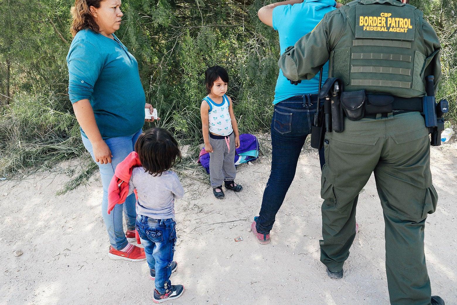 Little kids watch as Border Patrol agents take asylum seekers into custody