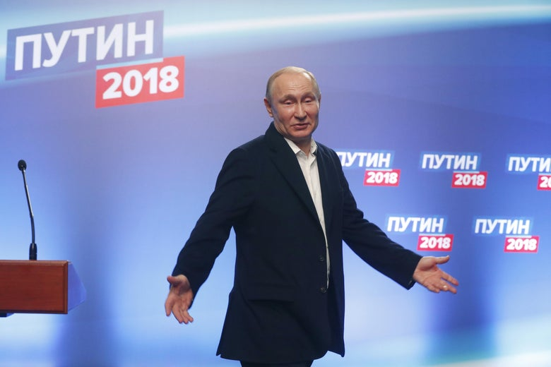 President Vladimir Putin meets with the media at his campaign headquarters in Moscow on March 18, 2018.