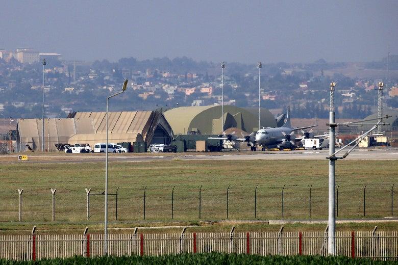 A plane sits near a hangar at an air base in Turkey.