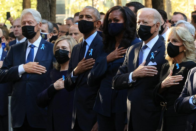 Former President Bill Clinton, former First Lady Hillary Clinton, former President Barack Obama, former First Lady Michelle Obama, President Joe Biden, and First Lady Jill Biden stand for the national anthem during the annual 9/11 Commemoration Ceremony at the National 9/11 Memorial and Museum on September 11, 2021 in New York City.