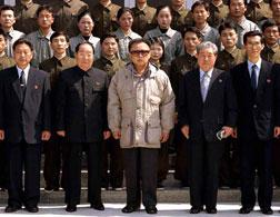 Kim Jong Il posing with staff of the General Satellite Control and Command Centre. Click image to expand.