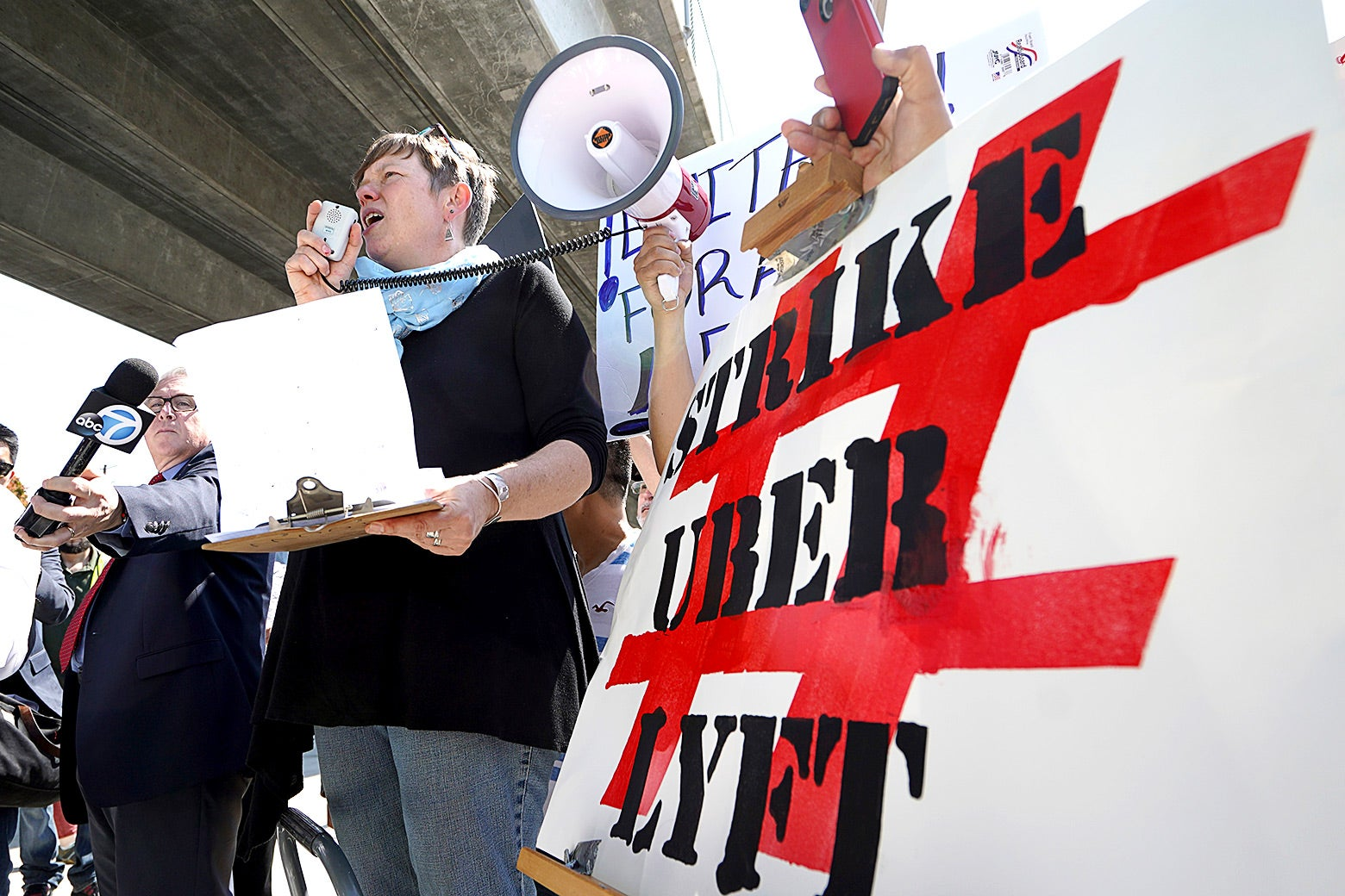 Driver and strike organizer Nicole Moore speaks during a one-day strike against Uber and Lyft in front of an Uber office.