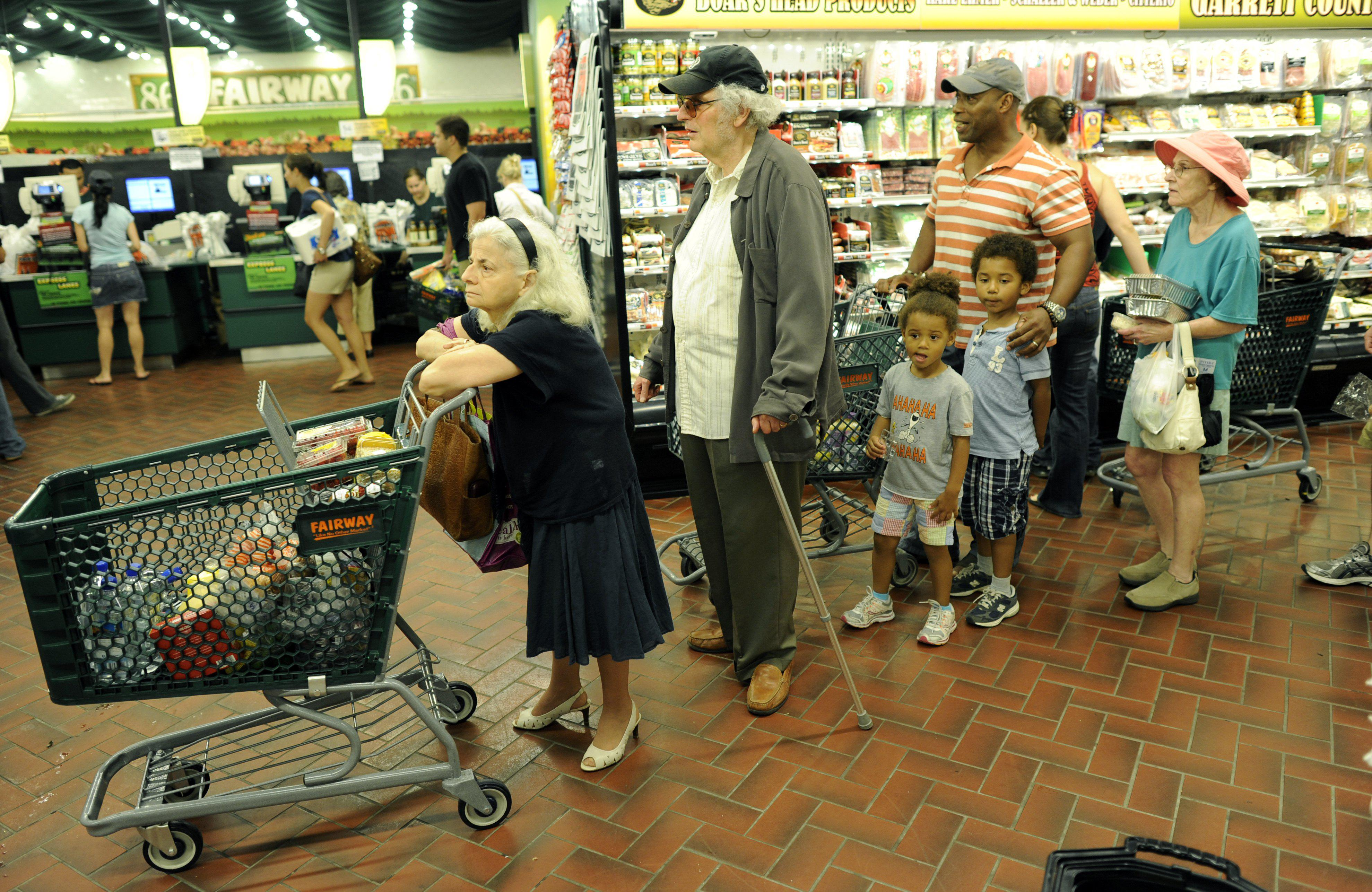 New Yorkers line up for the checkout line at the Fairway Supermarket on the Upper East Side of New York as Hurricane Irene continued toward the East Coast