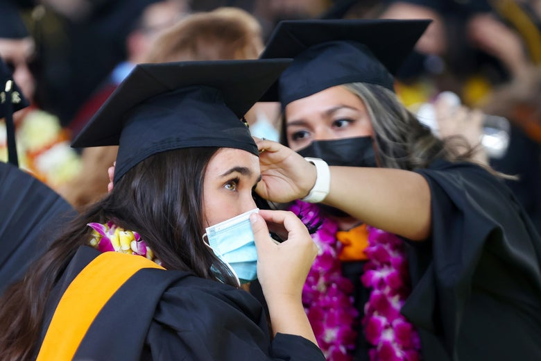 Cal State Los Angeles graduates prepare for their commencement ceremony which was held outdoors beneath a tent on campus on July 27, 2021 in Los Angeles, California.