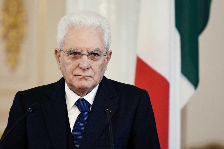 Italian President Sergio Mattarella standing behind a lectern.