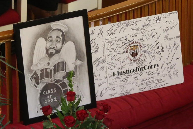Signs are displayed at the front of the church during the funeral held for Corey Jones.