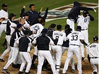 The Detroit Tigers celebrate. Click image to expand.