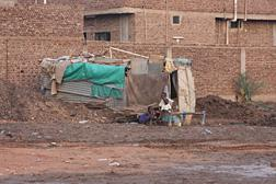 A displaced southerner's makeshift structure in a suburb of Khartoum.