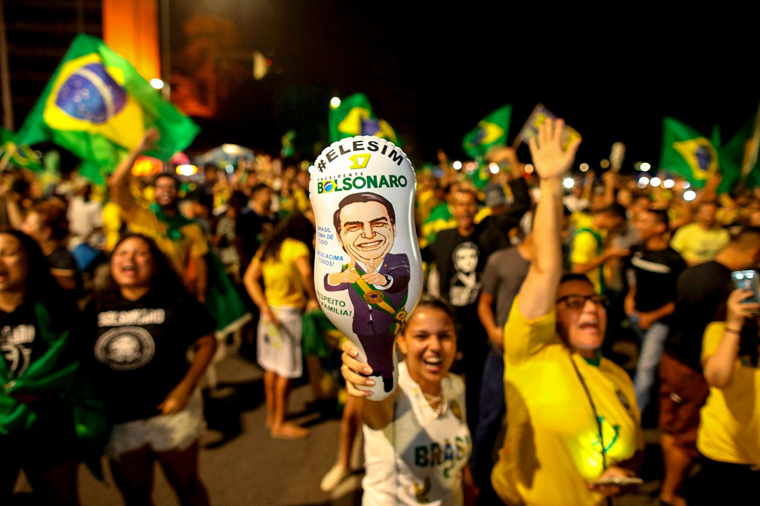 Supporters of Brazilian President-elect Jair Bolsonaro celebrate in front of the National Congress in Brasilia on Sunday.