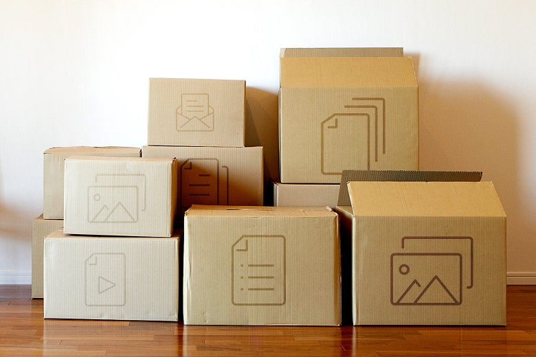 Cardboard moving boxes with app icons on them, stacked against a wall.