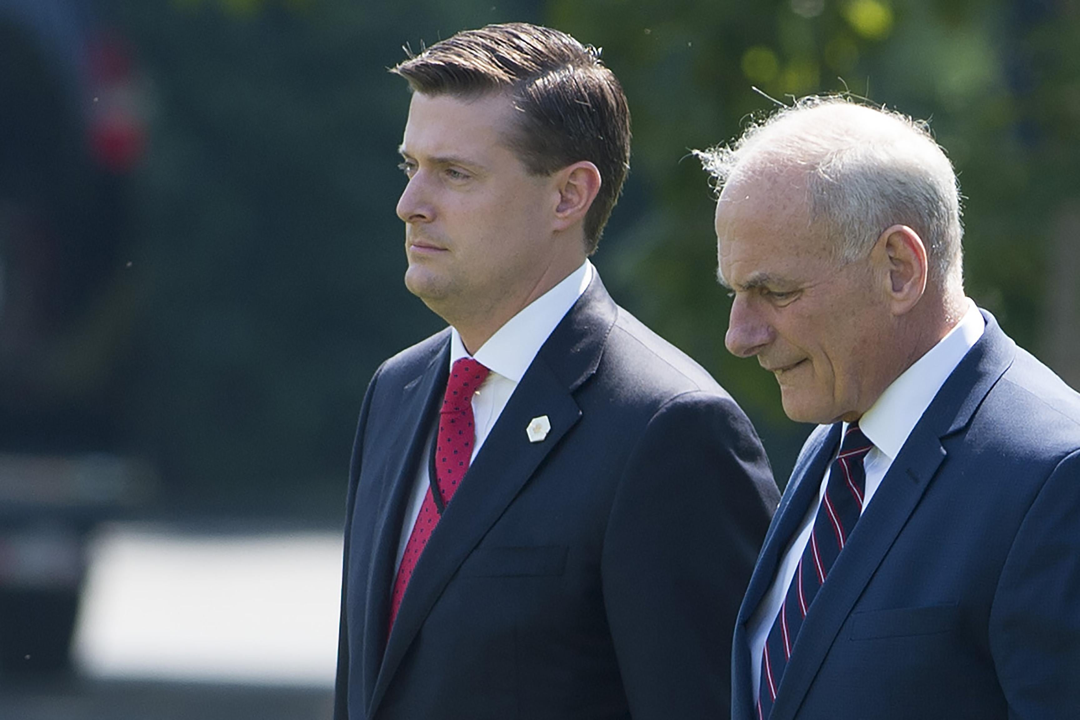 White House Chief of Staff John Kelly (R) and Former White House Staff Secretary Rob Porter (L) outside the White House on August 4, 2017.