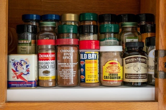 The three-tiered Expand-A-Shelf riser with spices on it.
