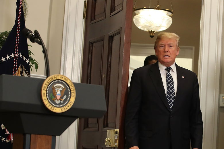 President Donald Trump walks into the Roosevelt Room in the White House to sign a proclamation to honor Martin Luther King Jr. Day on Friday in Washington.