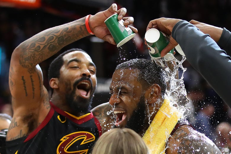 CLEVELAND, OH - APRIL 25:  LeBron James #23 of the Cleveland Cavaliers is showered with water by JR Smith #5 while being interviewed after a 98-95 win over the Indiana Pacers in Game Five of the Eastern Conference Quarterfinals during the 2018 NBA Playoffs at Quicken Loans Arena on April 25, 2018 in Cleveland, Ohio. NOTE TO USER: User expressly acknowledges and agrees that, by downloading and or using this photograph, User is consenting to the terms and conditions of the Getty Images License Agreement. (Photo by Gregory Shamus/Getty Images)
