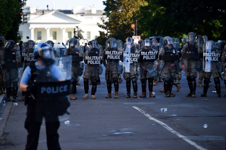 Military police hold the line near the White House on Monday.