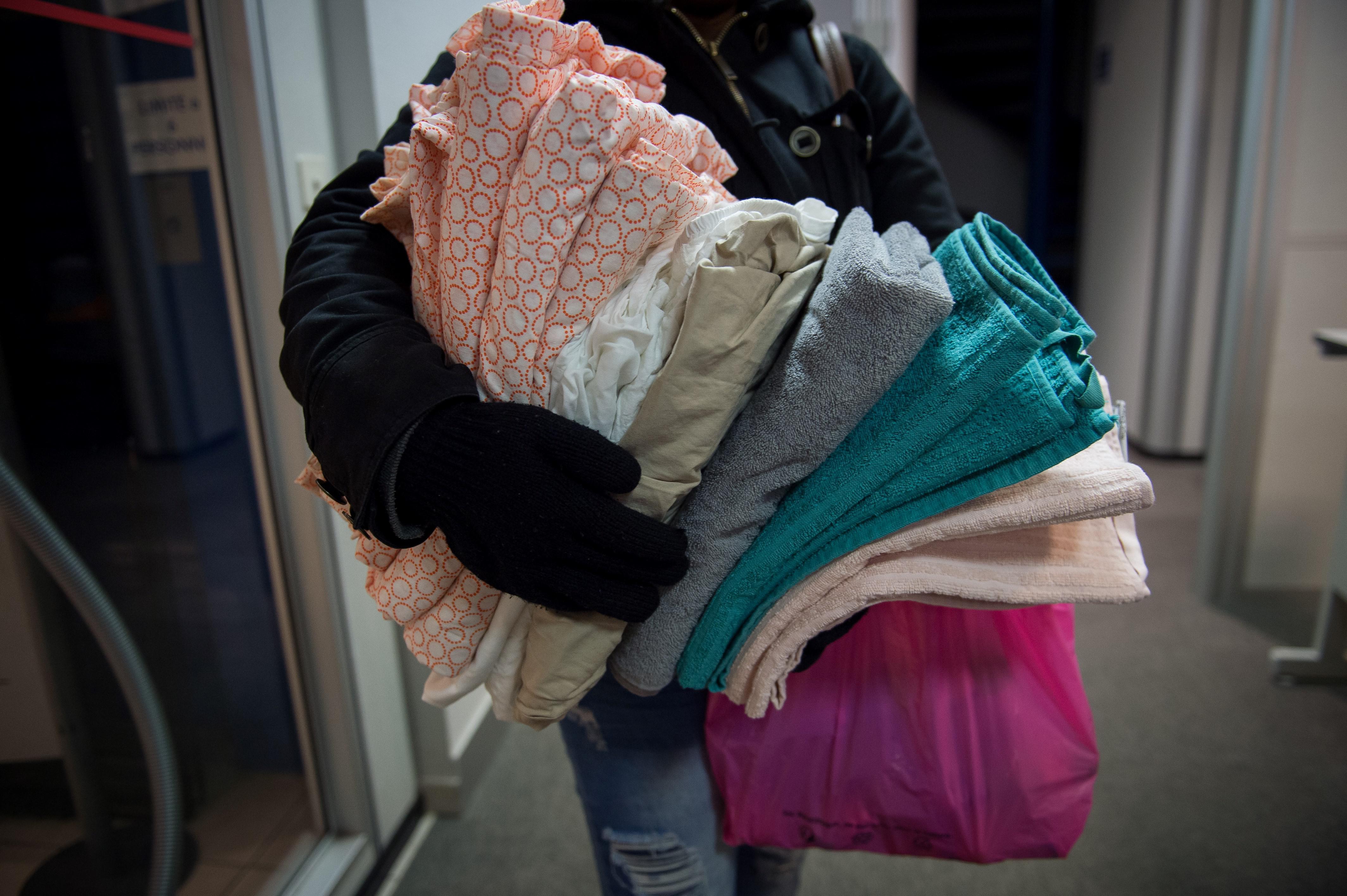 A man holds blankets inside a hosting center of December 18, 2017 in Orleans, central France.