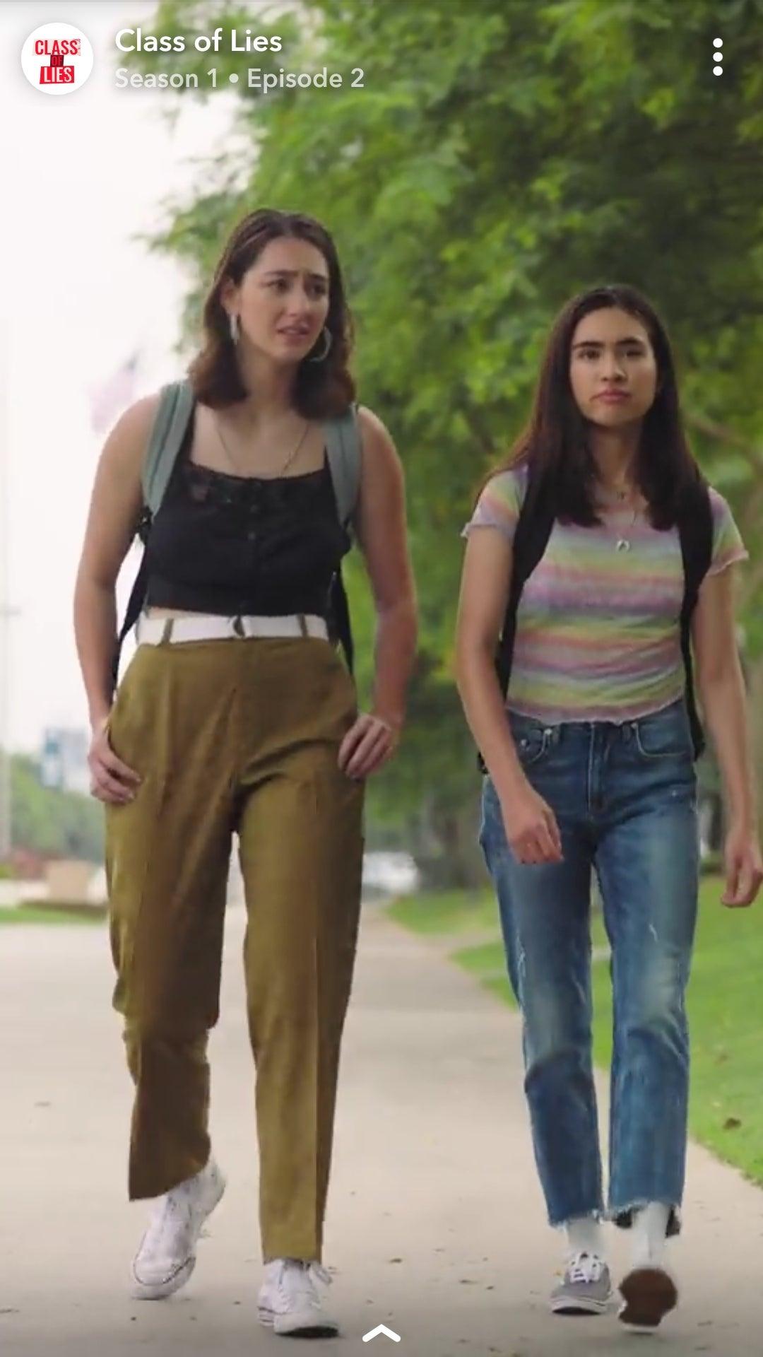 Two young women walking.