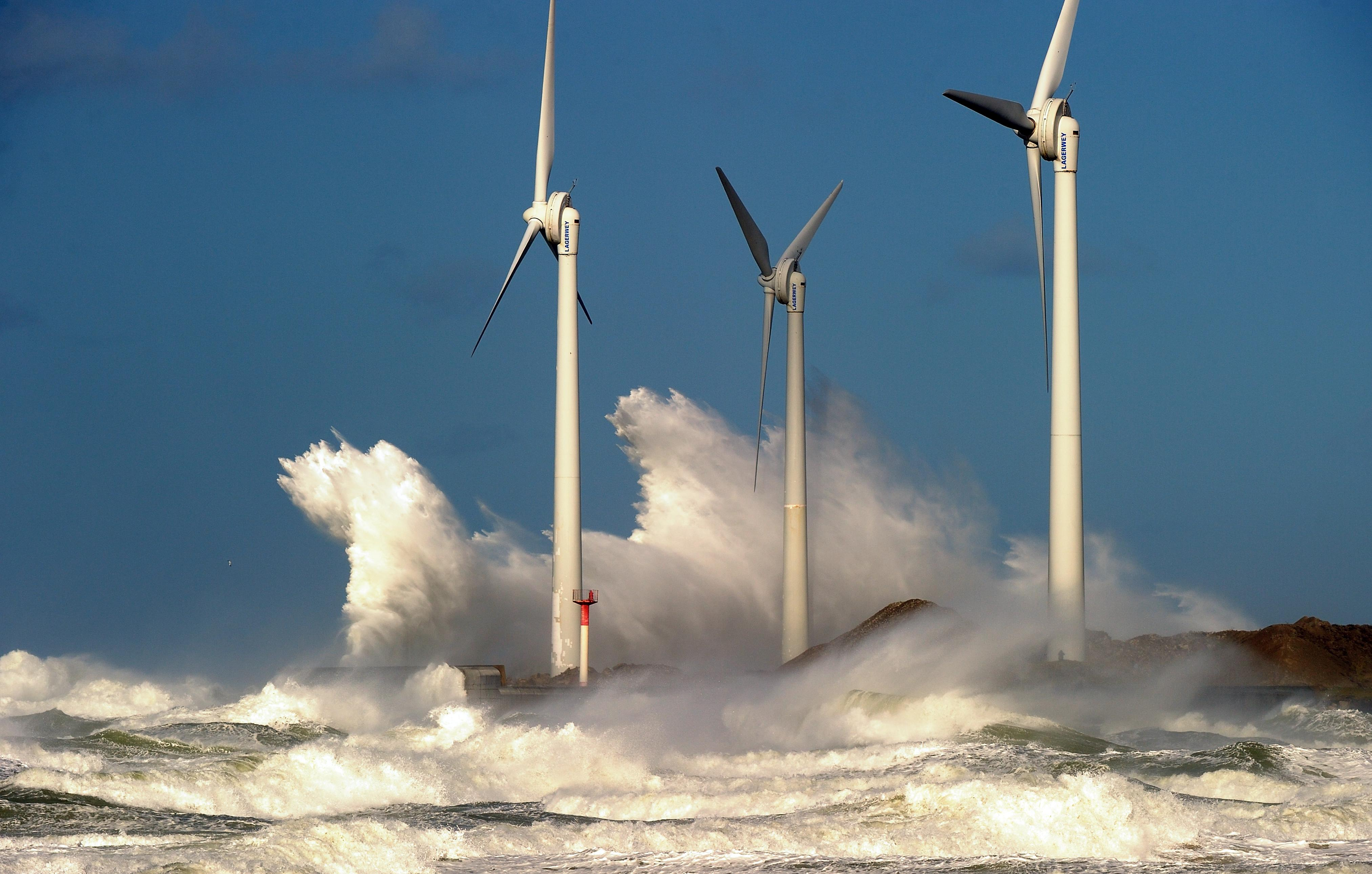 Waves break on a jetty holding wind turbines in the Channel port of Boulogne-sur-mer, France.
