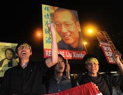 Protesters demonstrate to free Liu Xiaobo. Click image to expand.