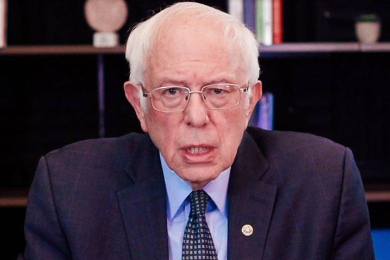 Bernie Sanders in front of a bookshelf.