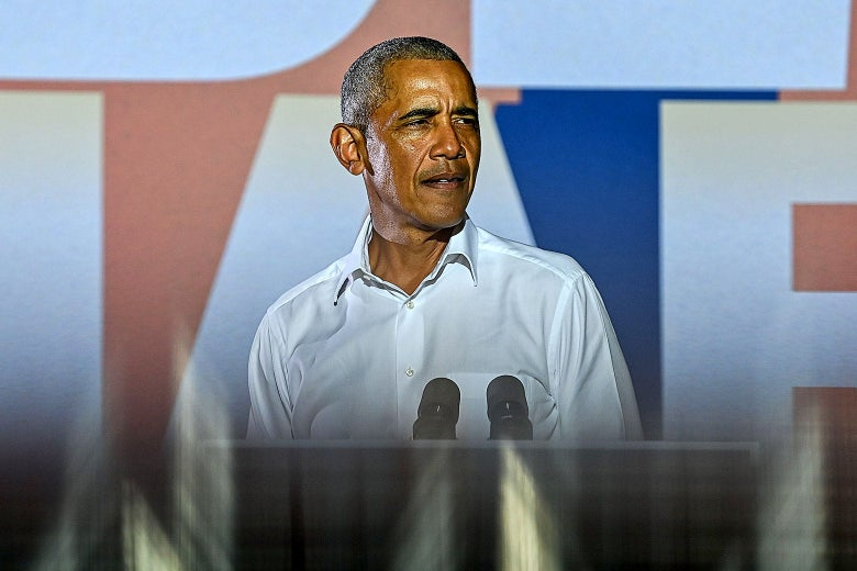 Barack Obama in a white button down, looking to the side.
