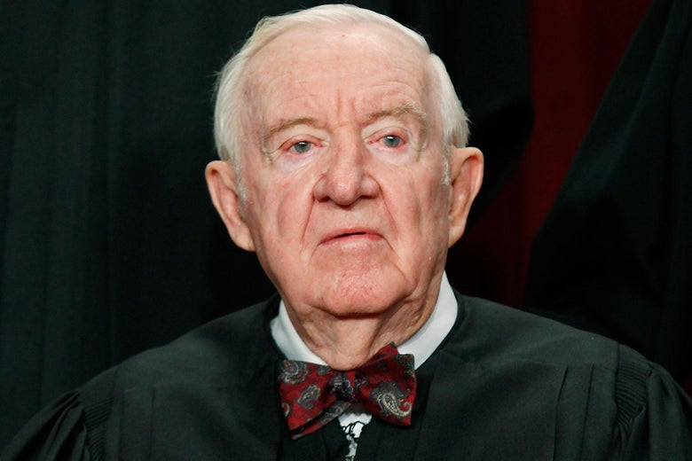 John Paul Stevens poses for a photo in his robes.