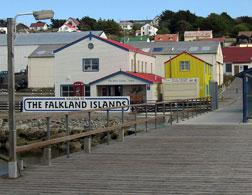 Stanley's tourist dock, where daytrippers are ferried ashore. Click image to expand.