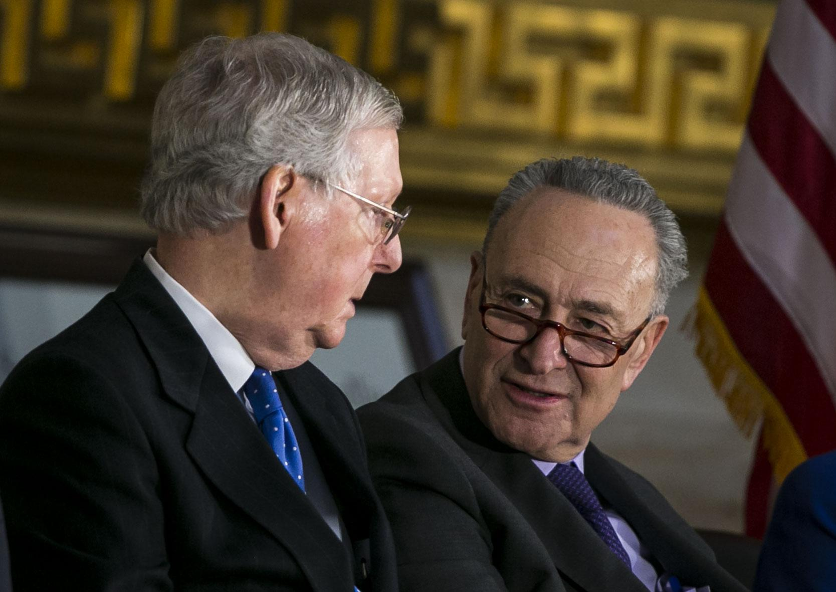 Senate Majority Leader Mitch McConnell and Senate Minority Leader Chuck Schumer talk at the U.S. Capitol on Wednesday.