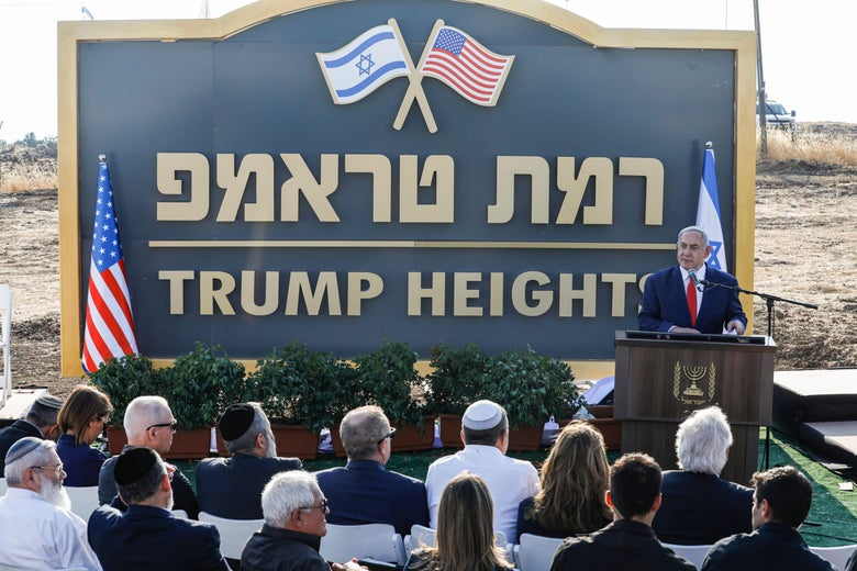 "Israeli Prime Minister Benjamin Netanyahu gives a speech before the newly-unveiled sign for the new settlement of ""Ramat Trump"", or ""Trump Heights"" on June 16, 2019."