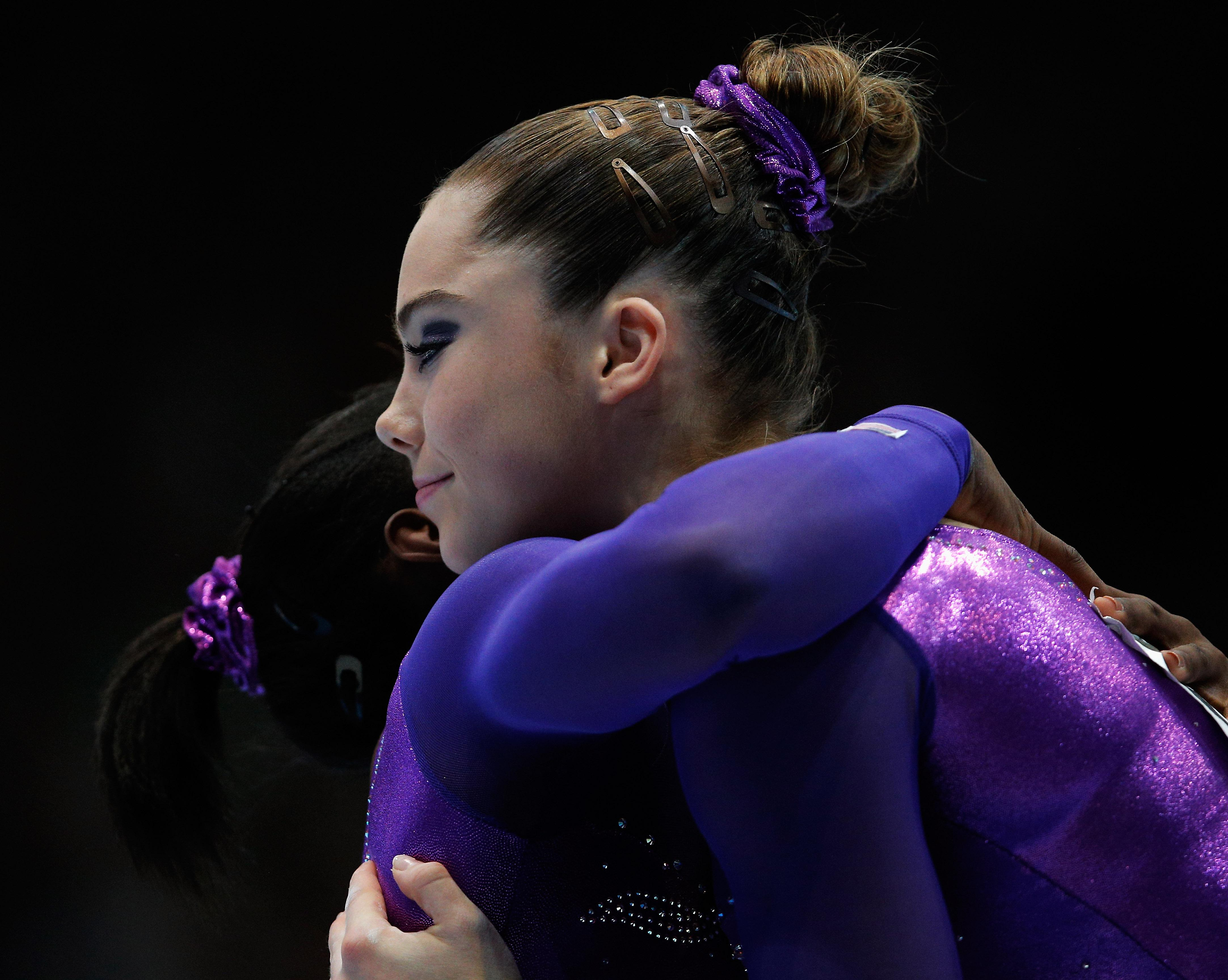 Simone Biles and McKayla Maroney both of USA embrace after the Vault Final on Day Six of the Artistic Gymnastics World Championships Belgium 2013 held at the Antwerp Sports Palace on October 5, 2013 in Antwerpen, Belgium.