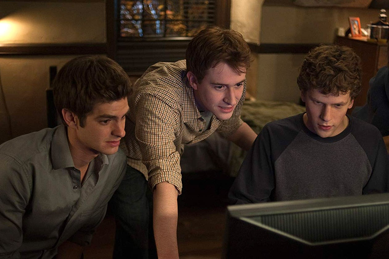 Andrew Garfield, Joseph Mazzello, and Jesse Eisenberg in The Social Network.