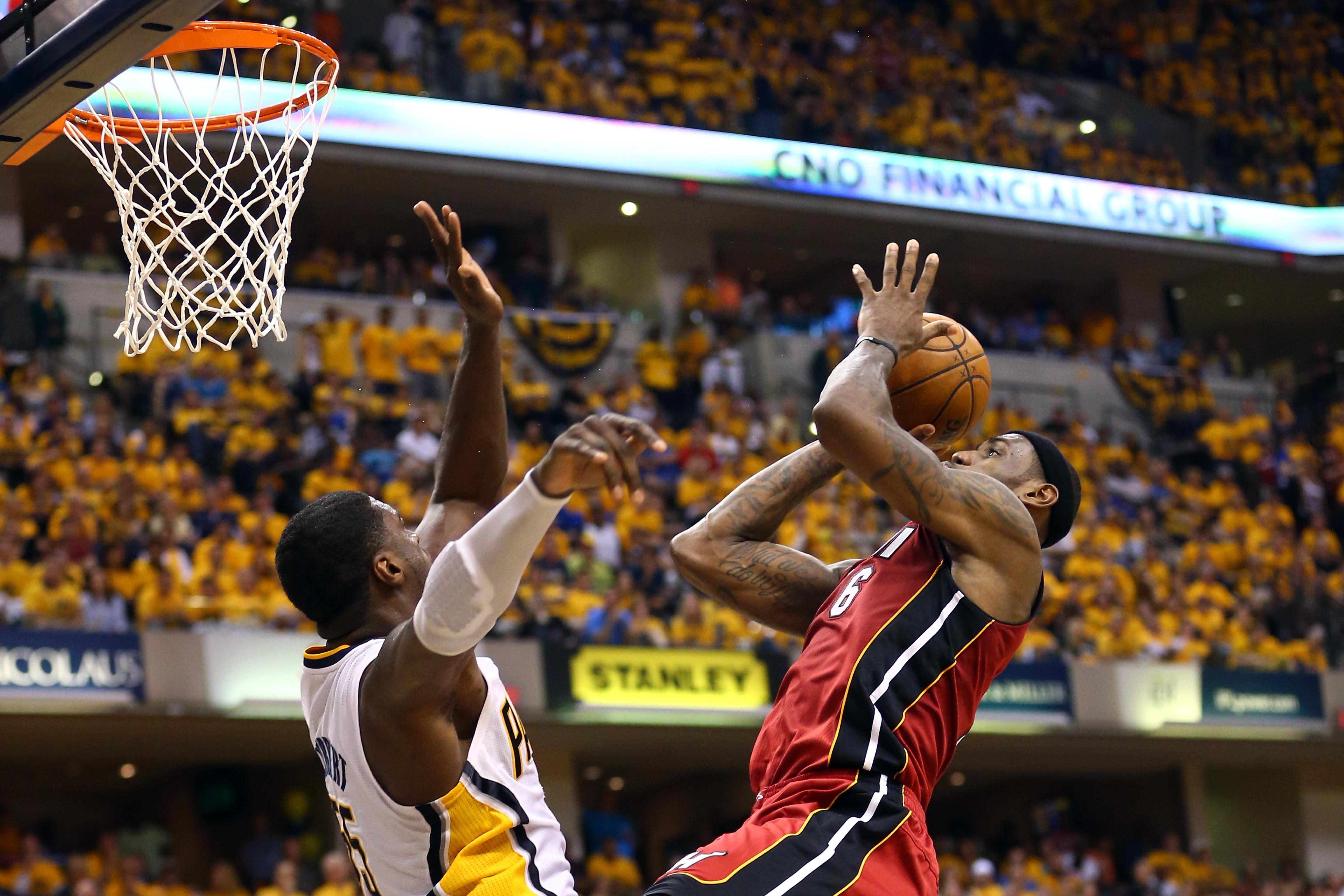 LeBron James, No. 6 of the Miami Heat, dunks the ball against Roy Hibbert, No. 55 of the Indiana Pacers, in Game 6 of the Eastern Conference Finals during the 2013 NBA Playoffs at Bankers Life Fieldhouse on June 1, 2013, in Indianapolis.