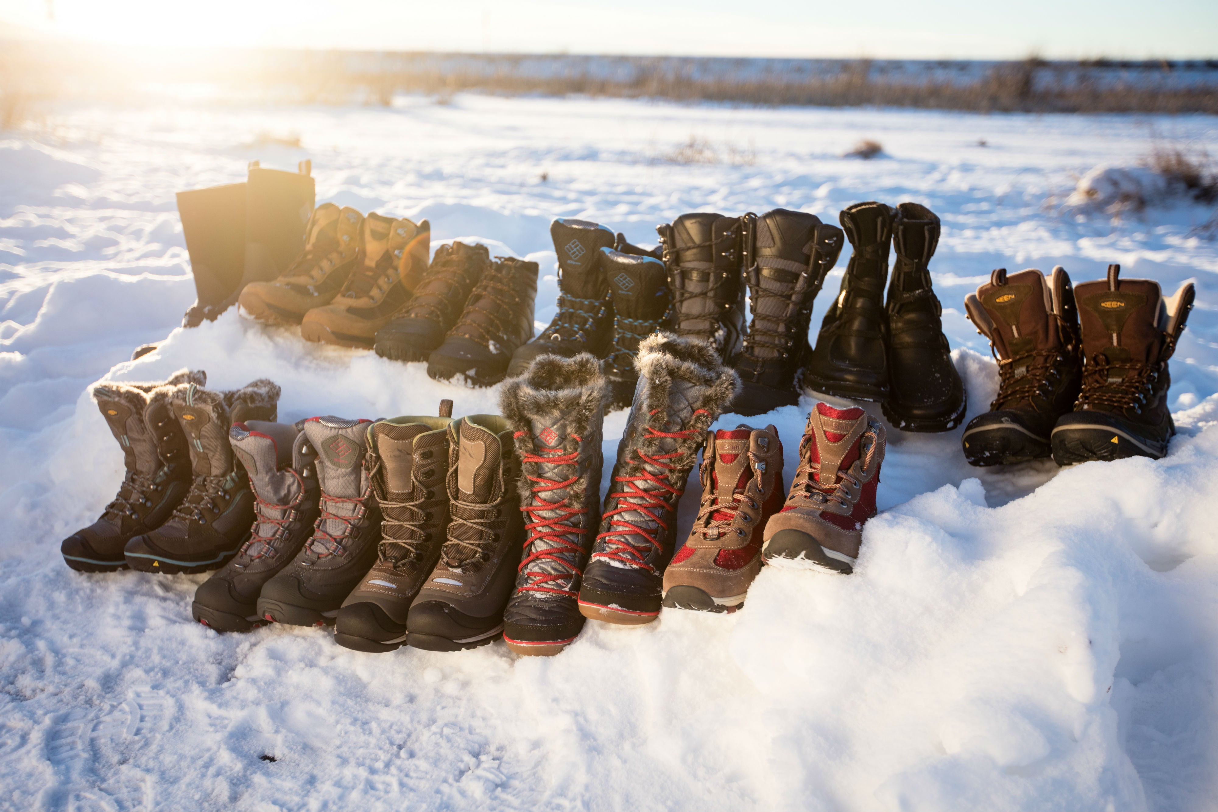 assorted winter boots in the snow