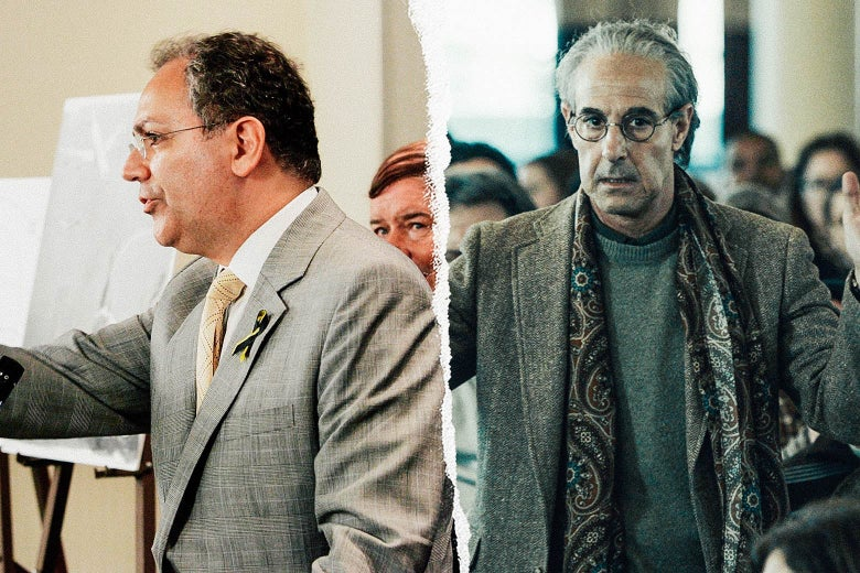 Two men in gray blazers and wire-rim glasses.