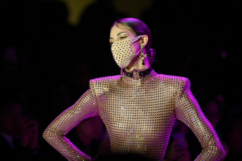 a model wearing a glittery mask that matches her shirt