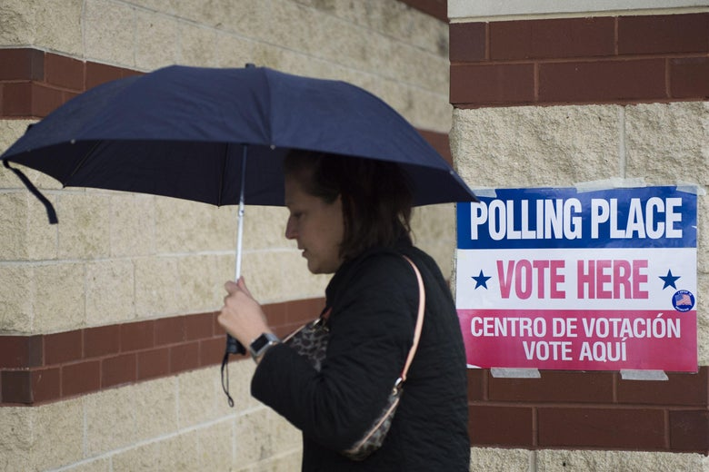 A Virginia woman walks to a polling station to cast a vote.