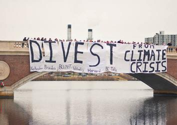 Divest Harvard student action in December 2013, Cambridge, Mass.