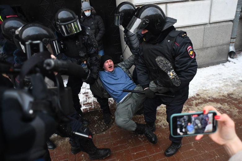 Police detain a man during a rally in support of jailed opposition leader Alexei Navalny in Saint Petersburg on January 31, 2021.