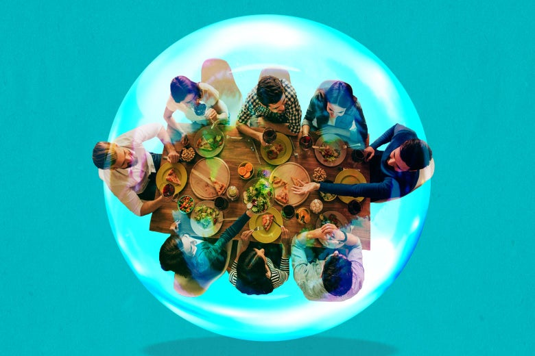 Eight people eating and talking at a dinner table, encased in a bubble.