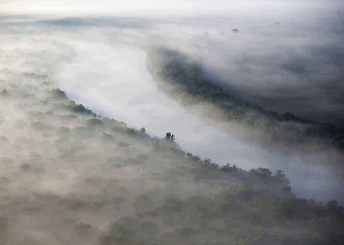 A fog slowly lifts over the Rio Grande which forms the U.S.-Mexico border on December 10, 2015 near La Grulla, Texas.