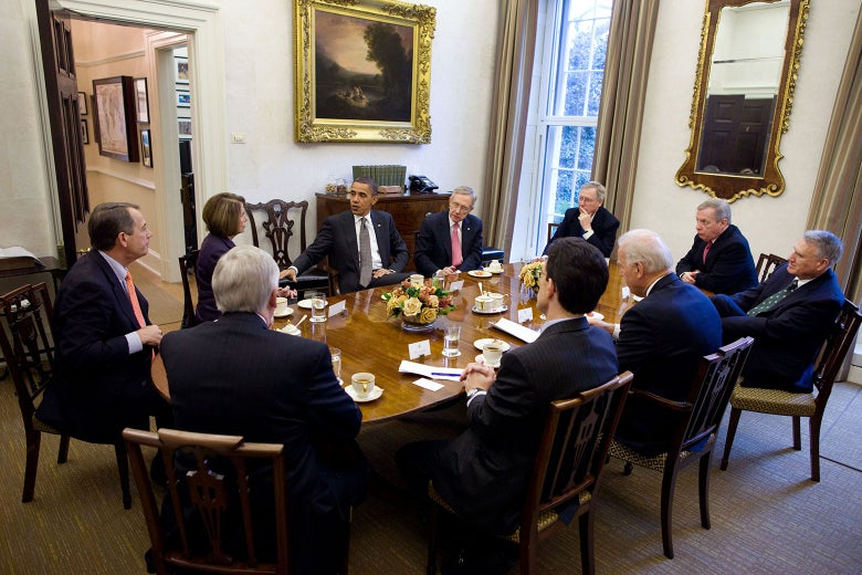 Obama meets with officials in the Presidential Dining Room.