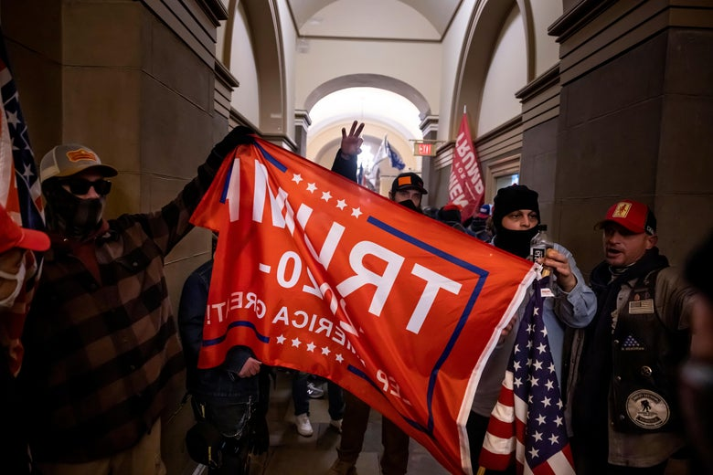 A Trump banner is held up during the Jan. 6 insurrection.