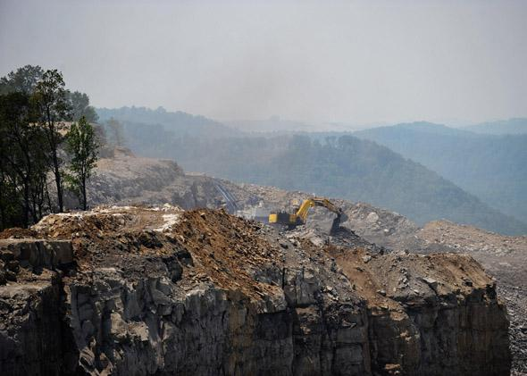 A June 12, 2008 photo shows heavy machinery working at a coal mine on top of Kayford Mountain in West Virginia.