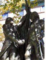 Washington and Lafayette shaking hands on Manhattan Avenue and 116th Street in Harlem