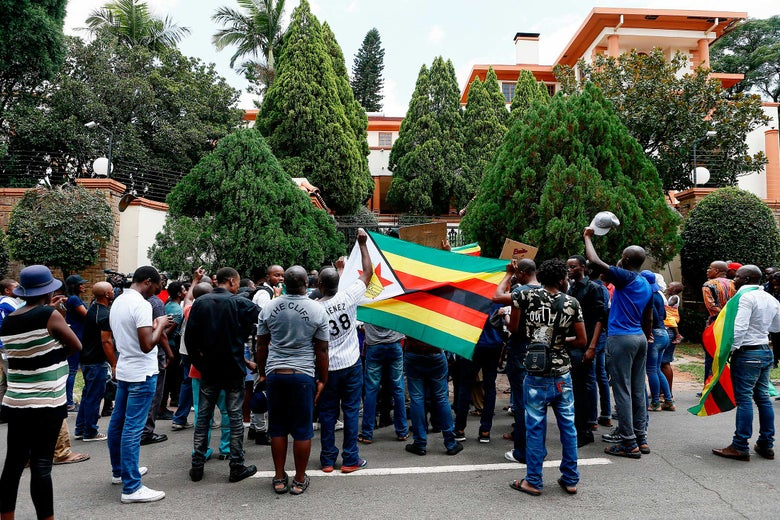 Protesters take part in a demonstration of Zimbabwean citizens outside the Zimbabwean Embassy in Pretoria on Wednesday.
