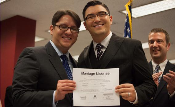 Brendon K. Taga (L) and Jesse Pageat, the second couple to receive a same-sex marriage license in Washington state.