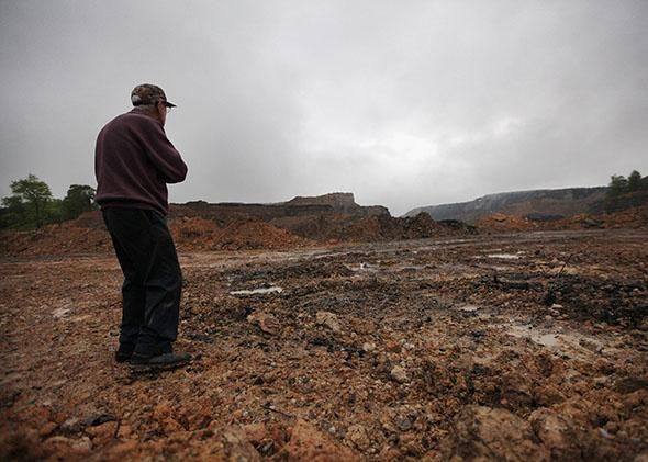 McKinley Sumner, 79, views surface coal mining operations near his home in the Appalachian Mountains on April 18, 2012, in Montgomery Creek, Kentucky.