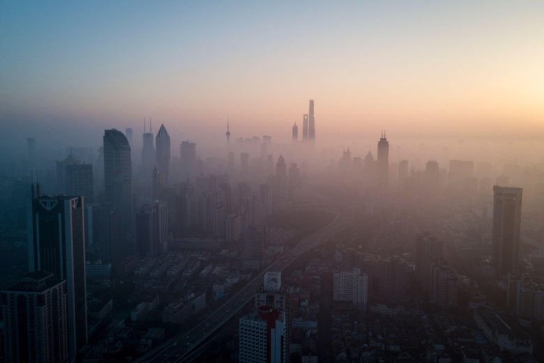 TOPSHOT - This overhead photo shows the sun rising above the skyline of Shanghai on a polluted day on February 23, 2018. (Photo by Johannes EISELE / AFP) (Photo by JOHANNES EISELE/AFP via Getty Images)