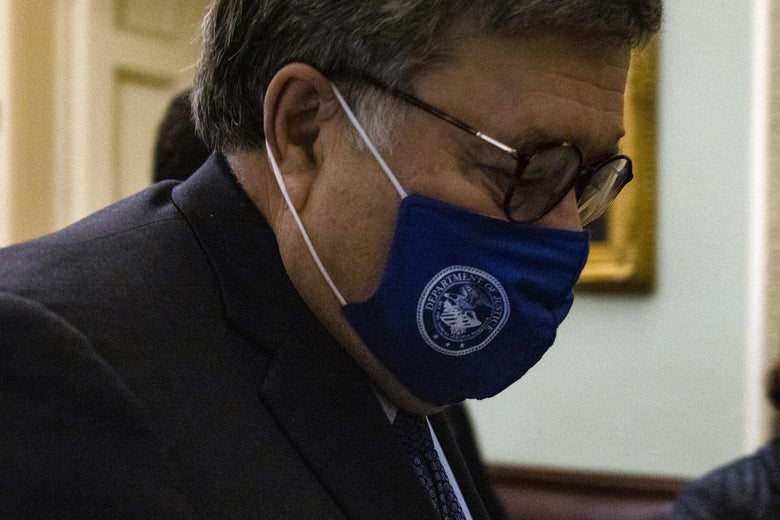Bill Barr at the Capitol, looking down and wearing a blue mask